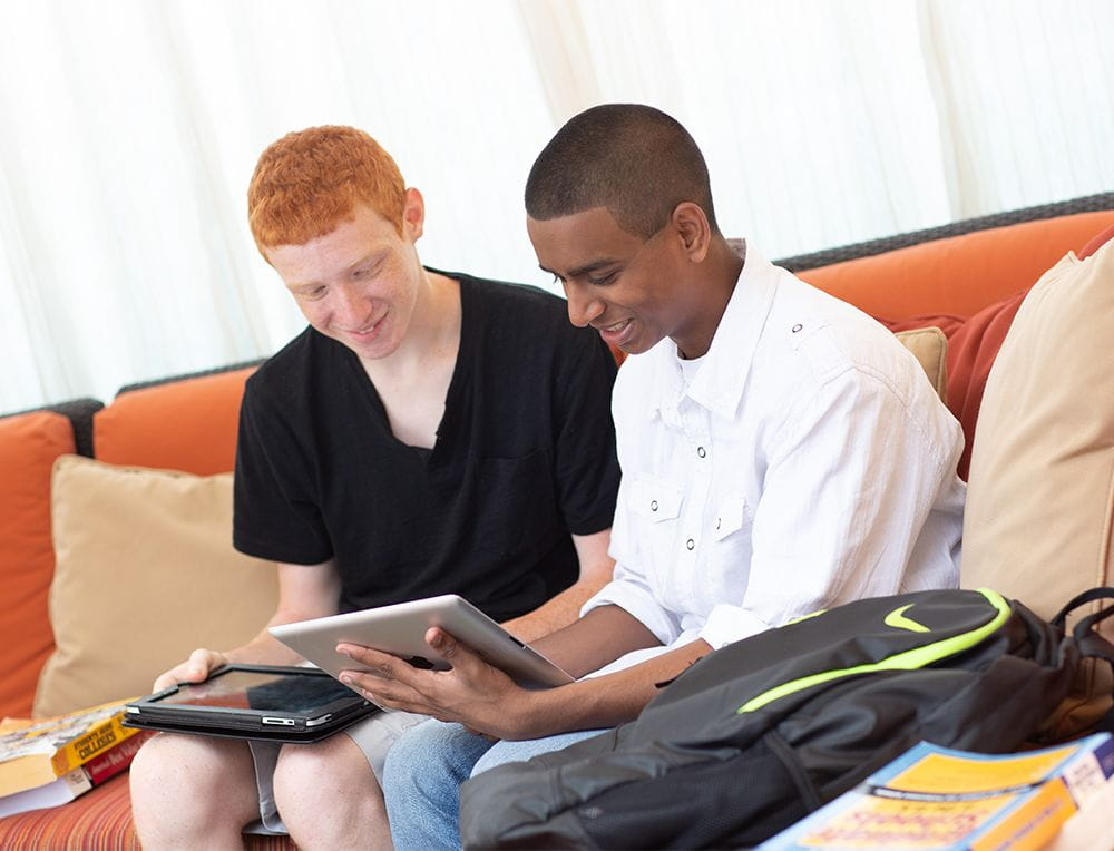 Two students looking at laptops